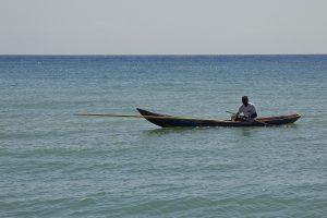 Fisherman in his canoe